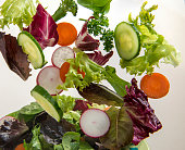 Mixed Fresh Salad being tossed in the air