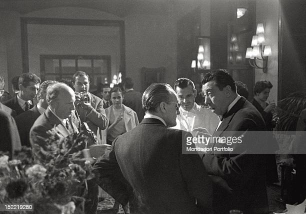 Totò and the French actor Fernandel in front of a group of fans and photographers In 1958 they play together in a film titled 'The Law Is the Law'...