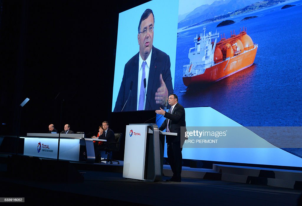 Total Chairman and CEO Patrick Pouyanne addresses the group general meeting in Paris on May 24, 2016. / AFP / ERIC