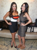 Total Diva Nikki Bella and WWE Total Diva Brie Bella celebrate SummerSlam at the London West Hollywood on August 14 2013 in West Hollywood California