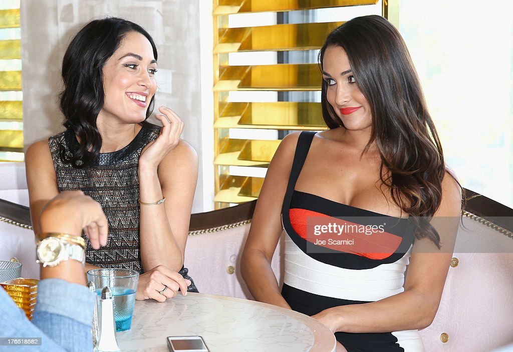Total Diva Nikki Bella and WWE Total Diva Brie Bella celebrate SummerSlam at the London West Hollywood on August 14, 2013 in West Hollywood, California.