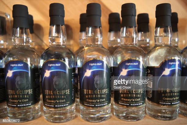 Total Eclipse Moonshine which was distilled to commemorate the upcoming solar eclipse is offered for sale at Casey Jones Distillery on August 16 2017...