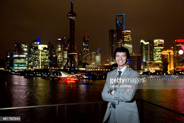 Total International Procurement Office Deputy General Manager Franck Filatriau poses for a photograph from the Bund with Pudong's business district's...