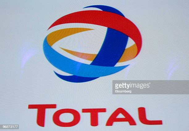 A Total SA logo is seen at a news conference in Paris France on Thursday Feb 11 2010 Total SA reported fourthquarter earnings that beat analyst...