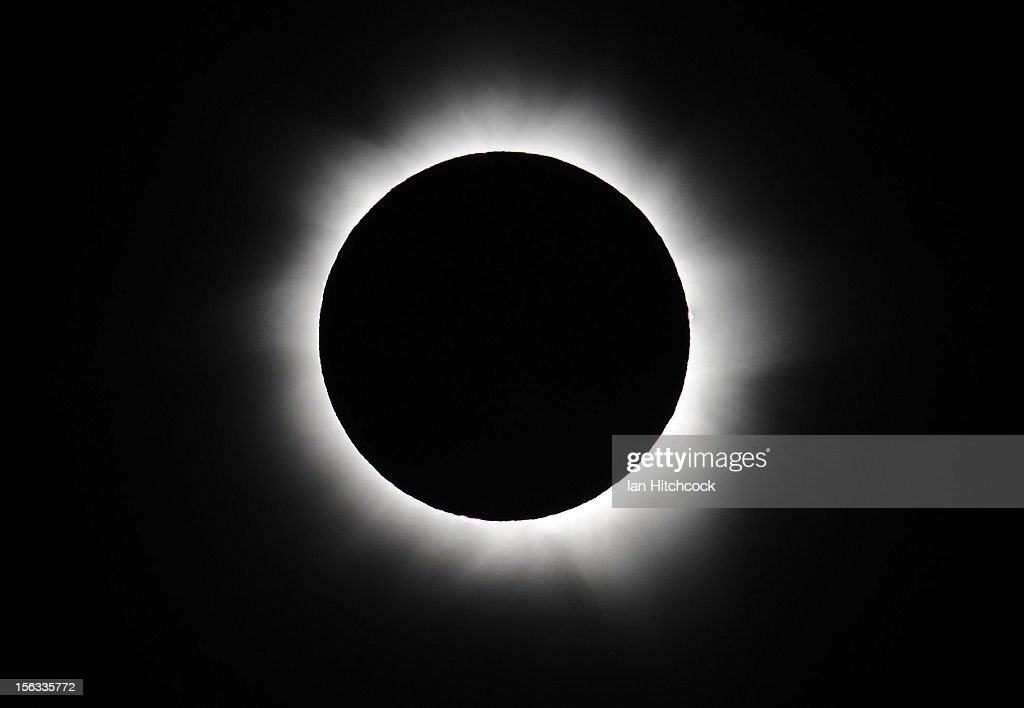 Totality is seen during the solar eclipse at Palm Cove on November 14 2012 in Palm Cove Australia Thousands of eclipsewatchers have gathered in part...