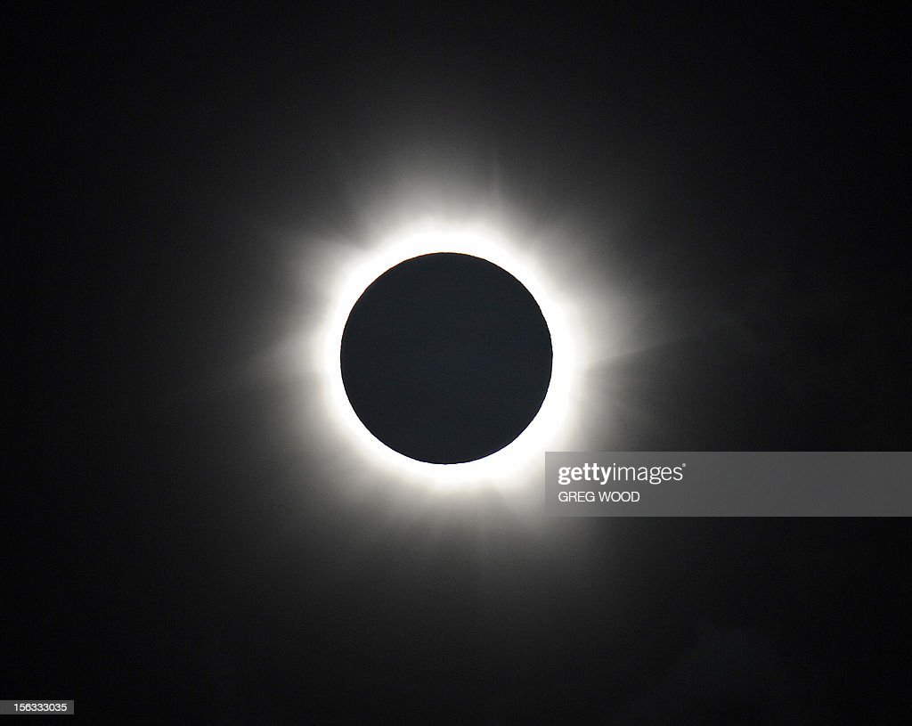 Totality is shown during the solar eclipse at Palm Cove in Australia's Tropical North Queensland on November 14, 2012. Eclipse-hunters have flocked to Queensland's tropical northeast to watch the region's first total solar eclipse in 1,300 years on November 14, which occurred as the moon passed between the earth and the sun, casting a shadow path on the globe and lasting for a maximum on the Australian mainland of 2 minutes and 5 seconds. AFP PHOTO / Greg WOOD