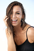 Portrait of an attractive young woman running her fingers through her wet hairhttp://195.154.178.81/DATA/istock_collage/0/shoots/782260.jpg
