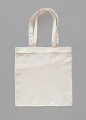 Tote bag canvas fabric cloth eco shopping sack mockup blank template isolated on grey background (clipping path)