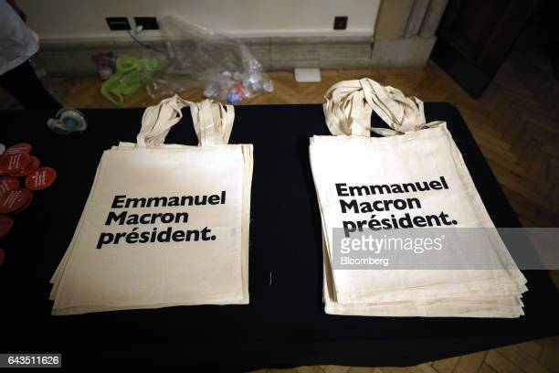 Tote bags sit on a desk before Emmanuel Macron French presidential candidate not pictured speaks at a campaign meeting with French expatriates at...