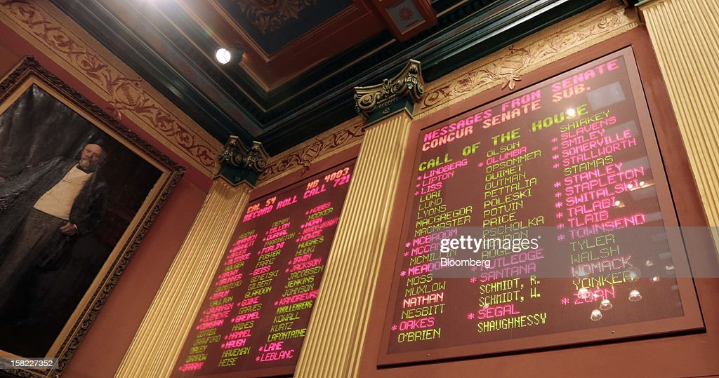 A tote board displays the final vote tally for H.B. 4003, a right to work bill passed by the Michigan House of Representatives, in the Capitol building in Lansing, Michigan, U.S., on Tuesday, Dec. 11, 2012. Michigan lawmakers approved bills to prohibit mandatory union dues in workplaces as thousands of chanting protesters thronged the Capitol. Photographer: Jeff Kowalsky/Bloomberg via Getty Images