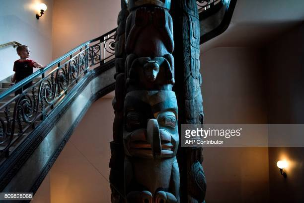 A totem pole is seen at the Smithsonian's Natural History Museum on July 6 2017 in Washington DC / AFP PHOTO / Brendan Smialowski