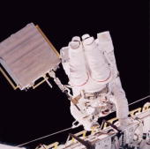 Toting the Mir Environmental Effects Payload astronaut Linda M Godwin STS76 mission specialist translates along the longerons of Atlantis'' cargo bay...