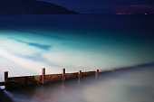 A long exposure of sun-down at Totland Bay on the Isle of Wight by the Waterfront Restaurant.