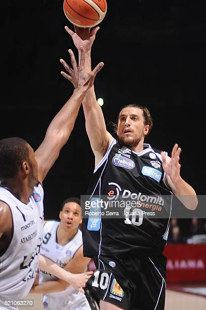 Toto Forray of Dolomiti Energia competes with Dexter Pittman and Abdul Gaddy of Obiettivo Lavoro during the LegaBasket match between Virtus Obiettivo...