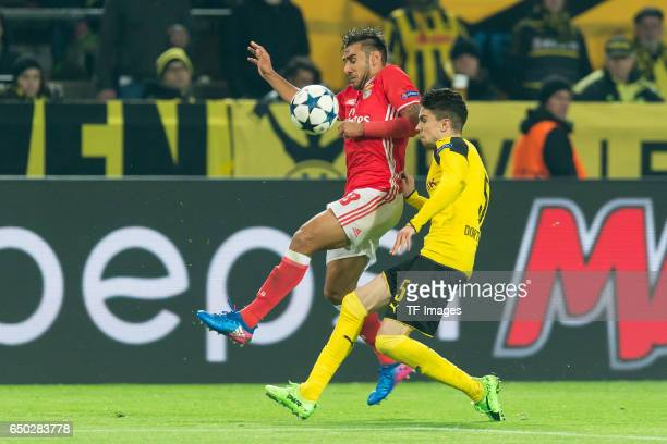 Toto Salvio of Benfica and Marc Bartra of Borussia Dortmund battle for the ball during the UEFA Champions League Round of 16 Second Leg match between...