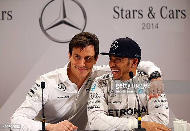 Toto Wolff the Mercedes GP Executive Director hugs Lewis Hamilton of Great Britain during a press conference at the annual Mercedes Benz Stars Cars...