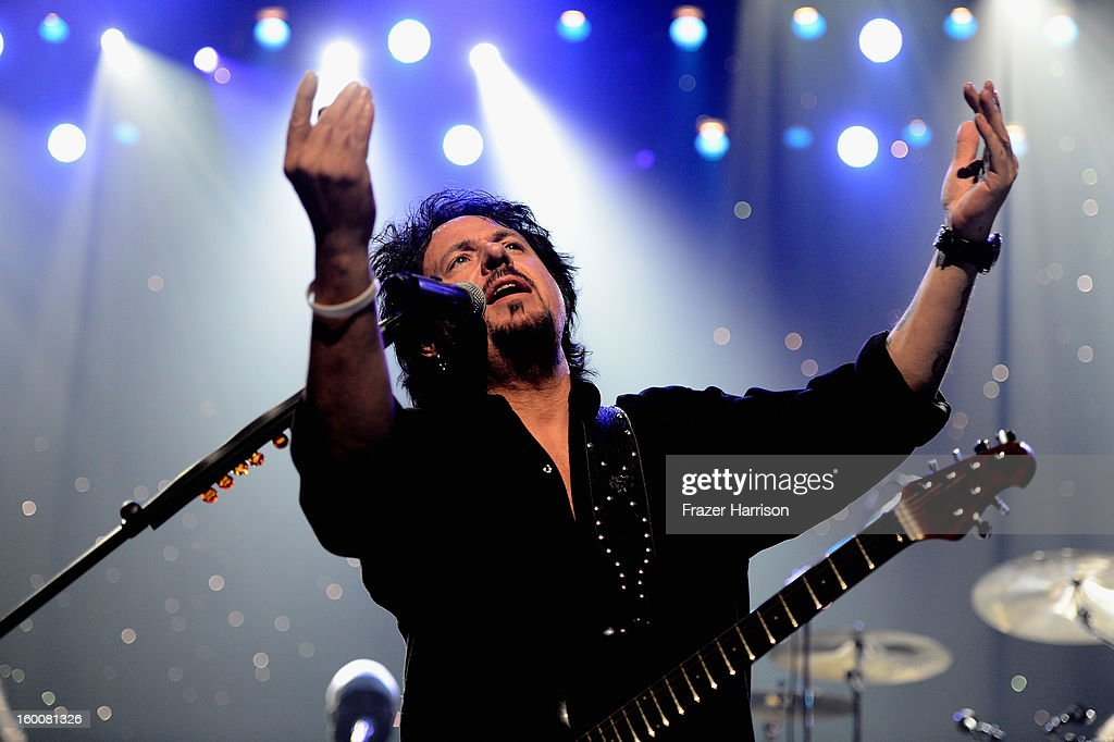 Toto's <a gi-track='captionPersonalityLinkClicked' href=/galleries/search?phrase=Steve+Lukather&family=editorial&specificpeople=624991 ng-click='$event.stopPropagation()'>Steve Lukather</a> celebrating Yamaha's 125th Anniversary Live Around the World Dealer Concert performs at the Hyperion Theater on January 25, 2013 in Anaheim, California.