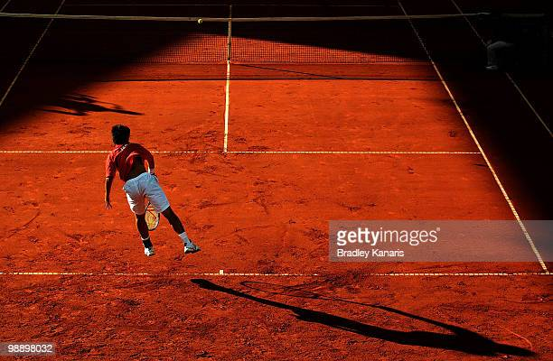 Totsuma Ito of Japan serves during his match against Lleyton Hewitt of Australia during the match between Australia and Japan on day one of the Davis...
