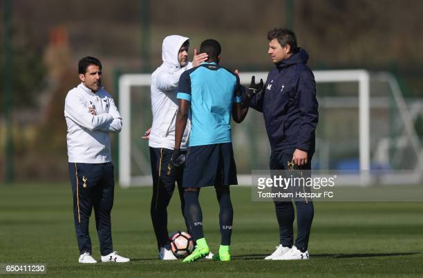 Tottenham assistant manager Jesus Perez manager Mauricio Pochettino and first team coach Miguel D'Agostino with Shilow Tracey during the Tottenham...