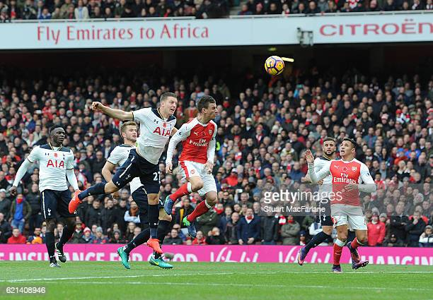 Tottenham defender Kevin Wimmer under pressure from Laurent Koscielny scores an own goal during the Premier League match between Arsenal and...