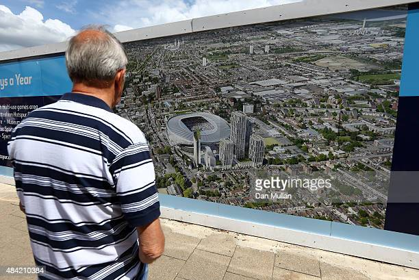 Tottenham fan takes a look at the new stadium plans prior to the Barclays Premier League match between Tottenham Hotspur and Stoke City on August 15...