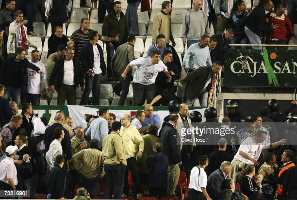 Tottenham fans fight with local police during their UEFA Cup quarter final match between Sevilla and Tottenham Hotspur at the Sanchez Pizjuan stadium...