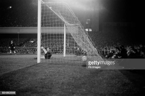 Tottenham goalkeeper Bill Brown's dive fails to stop the ball as George Eastham of Arsenal scored the first goal from a penalty The match ended 44