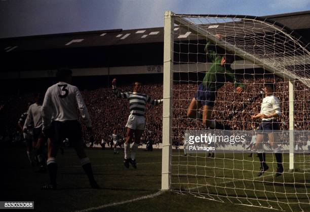 Tottenham goalkeeper Pat Jennings punches over during the preseason challenge match at Hampden Park Glasgow In the goalmouth Bertie Auld of Celtic