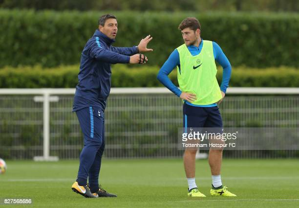 Tottenham head coach Miguel D'Agostino and Ben Davies during the Tottenham Hotspur training session at Tottenham Hotspur Training Centre on August 8...