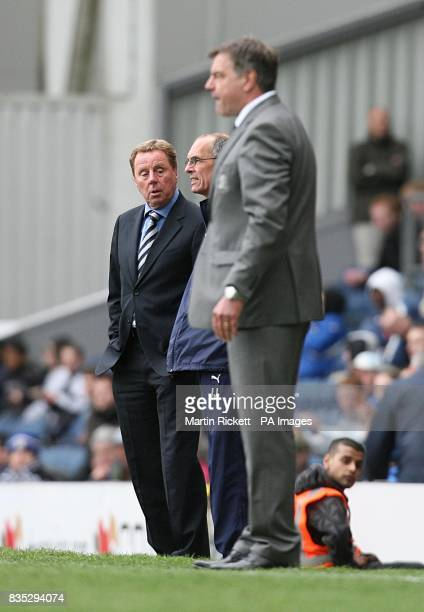 Tottenham Hotpsur manager Harry Redknapp chats with assistant Joe Jordan as Blackburn Rovers manager Sam Allardyce watches the action from the...