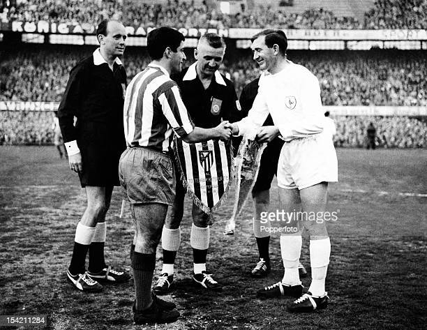 Tottenham Hotspur captain Danny Blanchflower exchanges pennants with Enrique Collar of Athletico Madrid watched by referee Andries Van Leeuwen prior...
