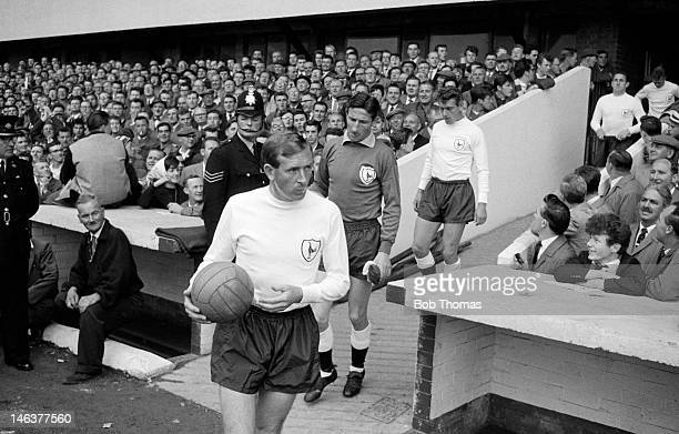 Tottenham Hotspur captain Danny Blanchflower leads his team onto the field at the Victoria Ground in Stoke prior to their First Division match...