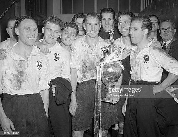 Tottenham Hotspur captain Ron Burgess alongside teammates with the League Championship trophy