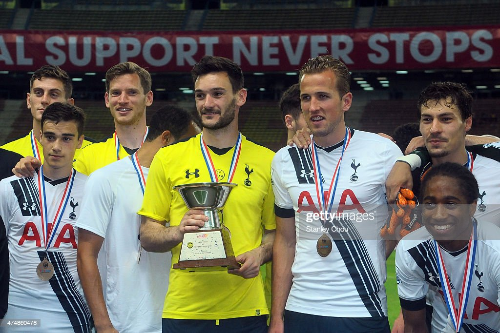 Tottenham Hotspur celebrates with the AIA Cup after they defeated Malaysia XI 2-1 during the pre-season friendly match between Malaysia XI and Tottenham Hotspur at Shah Alam Stadium on May 27, 2015 in Shah Alam, Malaysia.
