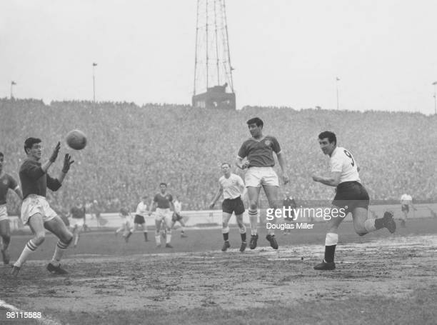 Tottenham Hotspur centreforward Bobby Smith beats Chelsea goalkeeper Peter Bonetti with a header to score Spurs' first goal during a match at...