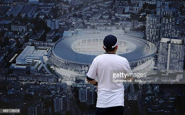 Tottenham Hotspur fan looks at the artists impression of the new stadium before the Barclays Premier League match between Tottenham Hotspur and...