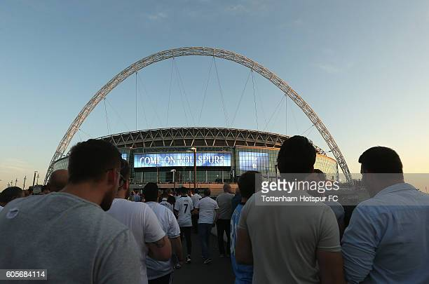 Tottenham Hotspur fans arrive at the stadium prior to the UEFA Champions League match between Tottenham Hotspur FC and AS Monaco FC at Wembley...