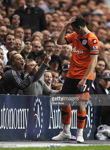 Tottenham Hotspur fans gesture towards Joey Barton of Queens Park Rangers during the Barclays Premier League match between Tottenham Hotspur and...