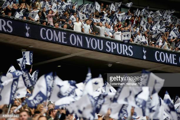 Tottenham Hotspur fans surport their team prior to the Premier League match between Tottenham Hotspur and Chelsea at Wembley Stadium on August 20...