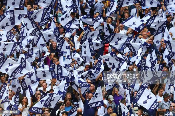 Tottenham Hotspur fans wave club flags before the Premier League match between Tottenham Hotspur and Chelsea at Wembley Stadium on August 20 2017 in...