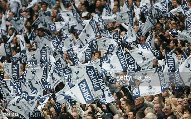 Tottenham Hotspur fans welcome their team prior to the Carling Cup Final between Tottenham Hotspur and Chelsea at Wembley Stadium on February 24 2008...
