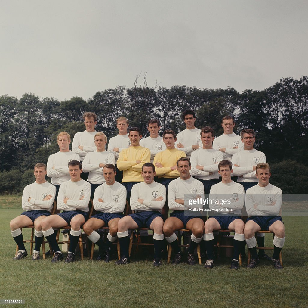 Tottenham Hotspur F.C. 1964-65 team squad members pictured at their training ground at Cheshunt, Hertfordshire on 31st July 1964. Back row, left to right: Laurie Brown, <a gi-track='captionPersonalityLinkClicked' href=/galleries/search?phrase=Peter+Baker+-+Soccer+Player+-+Born+1931&family=editorial&specificpeople=15371420 ng-click='$event.stopPropagation()'>Peter Baker</a>, <a gi-track='captionPersonalityLinkClicked' href=/galleries/search?phrase=Alan+Mullery&family=editorial&specificpeople=234848 ng-click='$event.stopPropagation()'>Alan Mullery</a>, Maurice Norman and Les Allen. Middle row, left to right: Frank Saul, Phil Beal, Bill Brown, <a gi-track='captionPersonalityLinkClicked' href=/galleries/search?phrase=Pat+Jennings&family=editorial&specificpeople=225090 ng-click='$event.stopPropagation()'>Pat Jennings</a>, Smith and <a gi-track='captionPersonalityLinkClicked' href=/galleries/search?phrase=Ron+Henry+-+Soccer+Player+-+Born+1934&family=editorial&specificpeople=13834975 ng-click='$event.stopPropagation()'>Ron Henry</a>. Front row from left to right: Cliff Jones, Cyril Knowles, <a gi-track='captionPersonalityLinkClicked' href=/galleries/search?phrase=Jimmy+Greaves&family=editorial&specificpeople=209221 ng-click='$event.stopPropagation()'>Jimmy Greaves</a>, Dave Mackay, Tony Marchi, Jimmy Robertson and Terry Dyson.