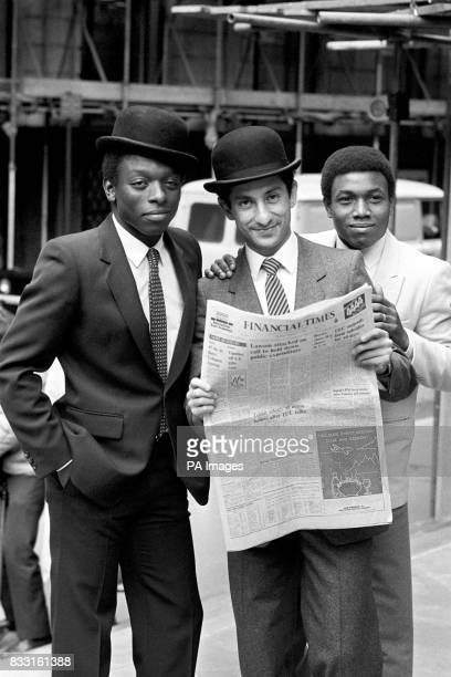 Tottenham Hotspur Football Club's soccer stars from the left Garth Crooks Ossie Ardilles and Danny Thomas stand outside the London Stock Exchange...