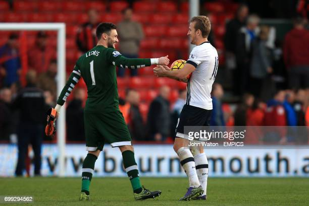 Tottenham Hotspur goalkeeper Hugo Lloris celebrates with teammate Tottenham Hotspur's Harry Kane at the end of the match