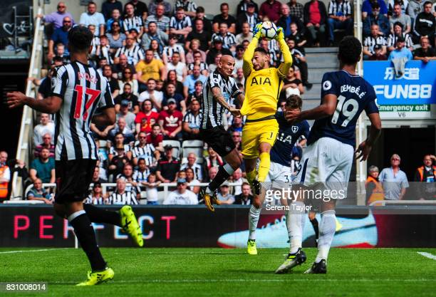 Tottenham Hotspur Goalkeeper Hugo Lloris jumps high in the air to catch the ball from Jonjo Shelvey of Newcastle United during the Premier League...