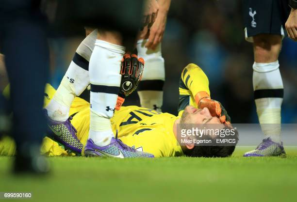 Tottenham Hotspur goalkeeper Hugo Lloris lies injured