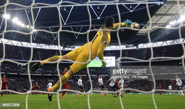 Tottenham Hotspur goalkeeper Hugo Lloris saves a shot from Liverpool's Philippe Coutinho during the Premier League match at the Wembley Stadium London