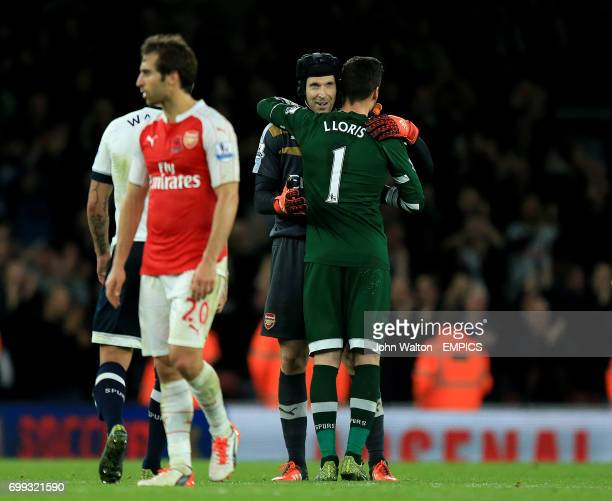 Tottenham Hotspur goalkeeper Hugo Lloris with Arsenal goalkeeper Petr Cech after the final whistle