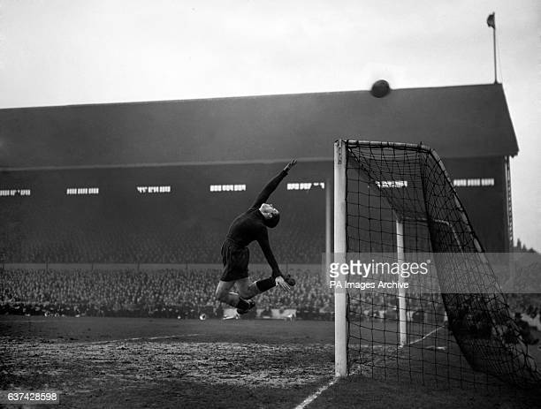 Tottenham Hotspur goalkeeper Ted Ditchburn pushes a shot over the bar