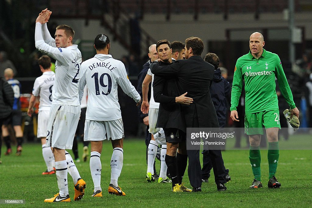 Tottenham Hotspur head coach Andre Villas-Boas embraces <a gi-track='captionPersonalityLinkClicked' href=/galleries/search?phrase=Javier+Zanetti&family=editorial&specificpeople=206966 ng-click='$event.stopPropagation()'>Javier Zanetti</a> of FC Internazionale Milano at the end of the UEFA Europa League Round of 16 Second Leg match between FC Internazionale Milano and Tottenham Hotspur at San Siro Stadium on March 14, 2013 in Milan, Italy.